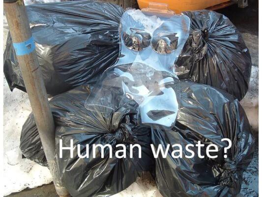 Human waste in garbage bags