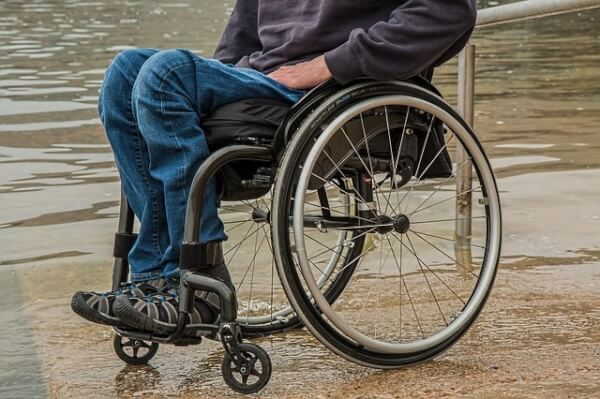 Man with disability in wheelchair